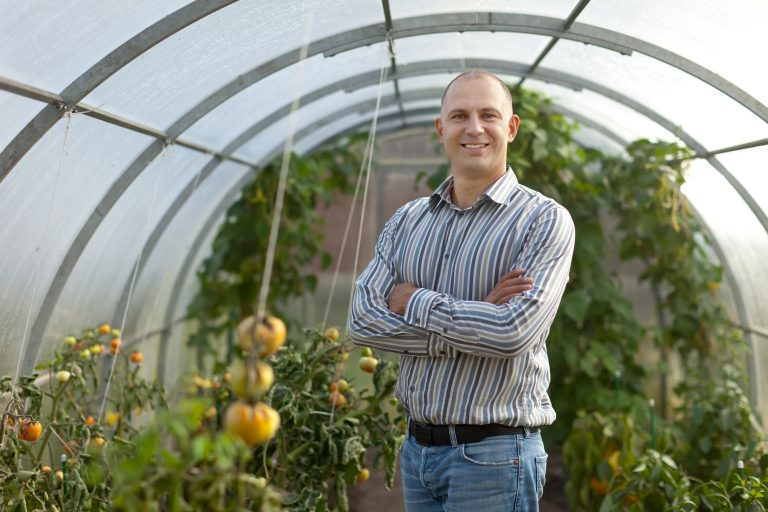 gardener in a polytunnel e1567283100790